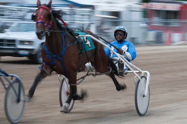 Ronnie Gillespie races during the 3rd Harness Race Thursday during the Effingham County Fair in Altamont. Gillespie won the 2013 driving championship at the fair. | Photo by Alexa Rogals