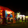 Fair-goers of the Effingham County Fair walk the Midway Monday night. | Photo by Cassie Porter
