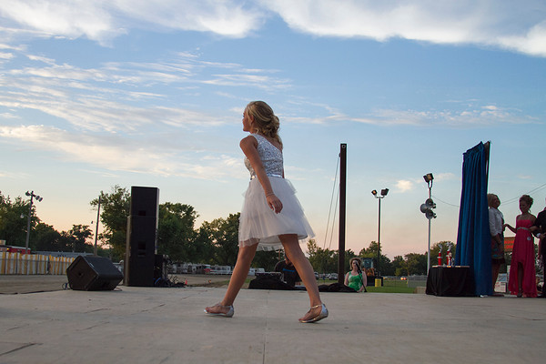 A contestant of the Effingham County Fair Junior Miss Pageant walks the stage Sunday to show off her formal wear. | Photo by Cassie Porter