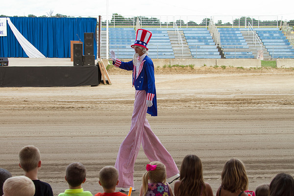 Uncle Sam waves at the crowd as he participates in the Twilight Parade Sunday during the Effingham County Fair. | Photo by Cassie Porter