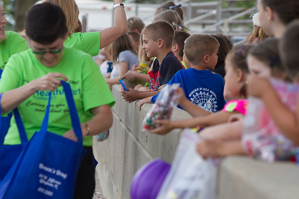 Children collect candy during the Effingham County Fair Twilight Parade as it passes through the Grand Stand before it ends. | Photo by Cassie Porter