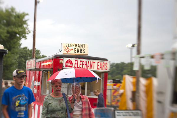 Despite the consistent rainfall, many fair-goers enjoyed the opening day of the Effingham County Fair. While some took shelter under pavilions, others utilized umbrellas, jackets and hats and continued to walk the fairgrounds.   Photo by Cassie Porter