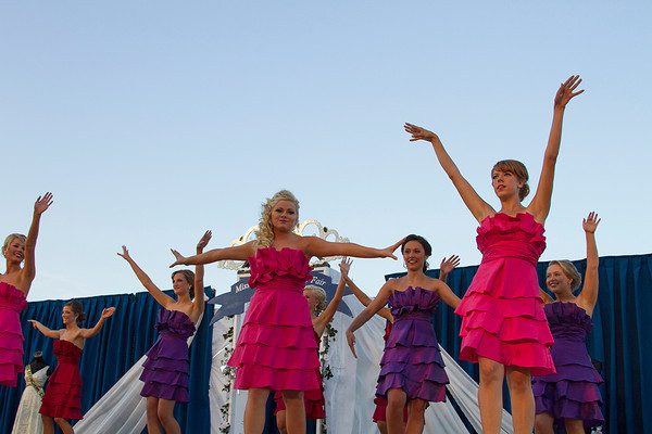 Miss Effingham County Fair Queen Pageant participants dance Tuesday during the Introduction of Contestants portion of the competition. | Photo by Cassie Porter