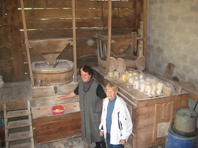 Joy in the mill with a woman making flour