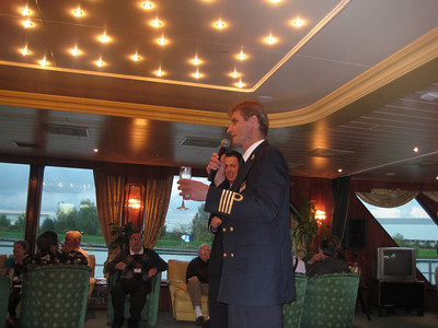 Captain Jurgen Luderer welcoming passengers at his reception.