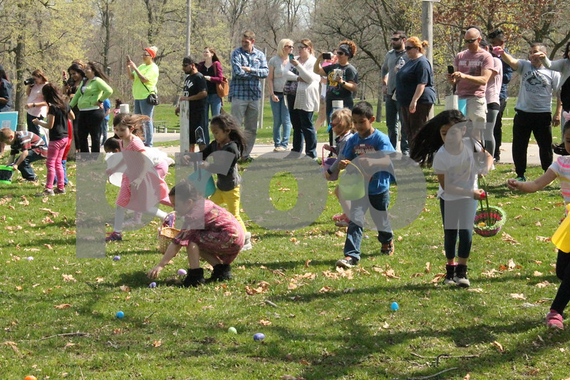 Local children find eggs at the DeKalb Park District's annual Easter Egg Hunt on Saturday at Hopkins Park, 1403 Sycamore Road in DeKalb.