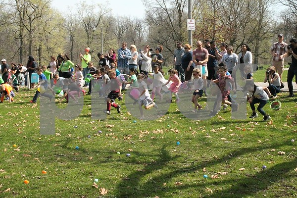 Local children run in search of eggs at the DeKalb Park District's annual Easter Egg Hunt on Saturday at Hopkins Park, 1403 Sycamore Road in DeKalb.