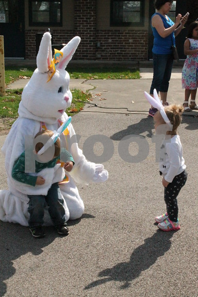 Logan Nunez, 3, and Madelyn Nunez, 18 months, of DeKalb pose for pictures with the Easter Bunny at DeKalb Park District's annual Easter Egg Hunt on Saturday at Hopkins Park, 1403 Sycamore Road in DeKalb.