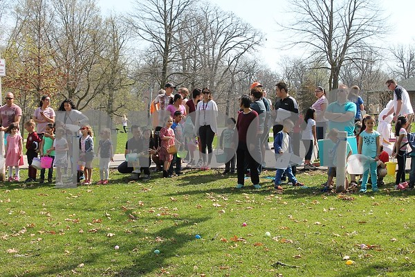 Local children wait for the DeKalb Park District's annual Easter Egg Hunt on Saturday at Hopkins Park, 1403 Sycamore Road in DeKalb.