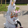 Madelyn Nunez, 18 months, of DeKalb, poses for a photo with the Easter Bunny at DeKalb Park District's annual Easter Egg Hunt on Saturday at Hopkins Park, 1403 Sycamore Road in DeKalb.