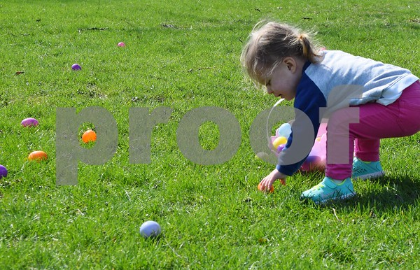 Madison Blackmer of Cherry Valley, 2, picks up an egg during the Easter Eggstravaganza on Saturday at Genoa Faith United Methodist Church, 325 S. Stott St. in Genoa.