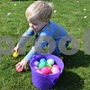 Brayden Boyer of Genoa, 2, races to hunt for eggs Saturday during the Easter Eggstravaganza at Genoa Faith United Methodist Church. In addition to the Easter egg hunt, the event also included a biscuits and gravy breakfast, cake walk, cupcake decorating and balloon animals.
