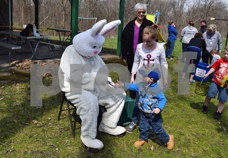 Hannah Disharoon, 9, and her brother Camden, 2, both of Kingston, visit with the Easter Bunny Saturday after an egg hunt at Kingston Township Park hosted by Hand in Hand.