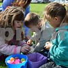 Children open the eggs they found during the Easter Eggstravaganza egg hunt Saturday at Genoa Faith United Methodist Church. Pictured (from left) are Sage Sweet, 7, of Davis Junction, and Mason Bade, 4, and Carsyn Bade,6, both of Kingston.