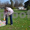 Pastor Melissa Meyers of Genoa Faith United Methodist Church scatters eggs for children to find during the church's Easter Eggstravaganza on Saturday. The event also featured a biscuits and gravy breakfast, a cake walk, cupcake decorating and balloon animals made by Hyunwoo Lee of Hinckley.
