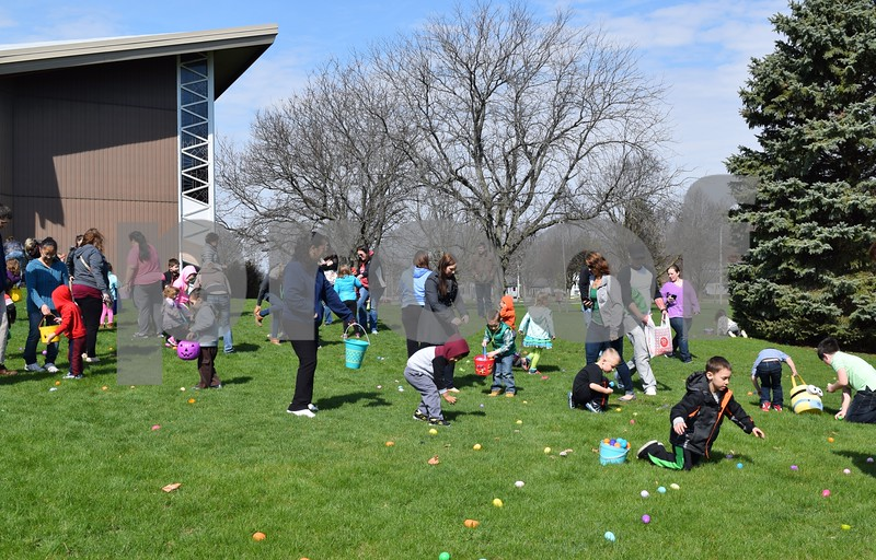 Children rush to find eggs Saturday during the Easter Eggstravaganza at Genoa Faith UMC. Approximately 2,500 eggs were scattered for four age groups to find.