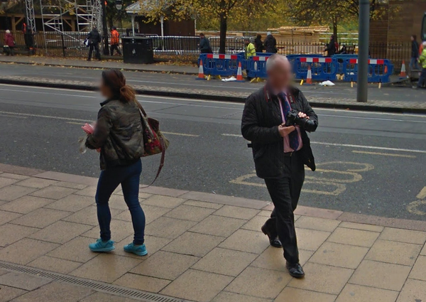 Man walking along Princes Street with Streetview camera on his back....