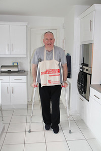 "December 2011 broken ankle - the nosebag is designed to allow me to carry small items about the house myself.   I'm unsure about the ""Come here - Go Anywhere"" sentiment, but I dare say I will be able to operate on both engines again at some point.   Thanks to Jayne for taking the snap."