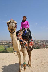 It was so incredible to be on a camel by the pyramids and Cairo in the background.