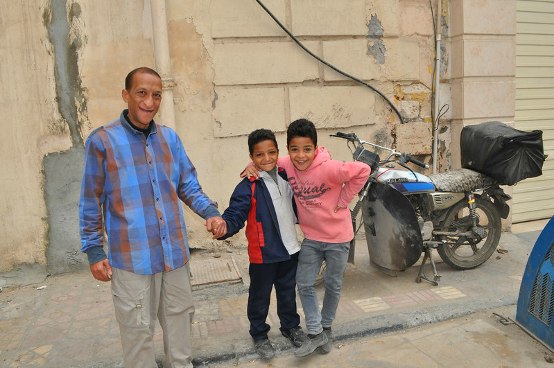 My sweet Egyptian friends who wanted to pose with the motorcycle.