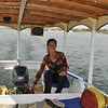 Having fun at the helm of a boat taxi on the Nile.