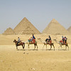 Caravaning across the desert charged by the great pyramids of Giza.