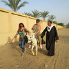 The Hungarian healers asked me to join them at the Sun Temple in Abu Ghurab. Here is the local Egyptian chief of the area sharing his donkey with one of the gals to make the trek easier for her.