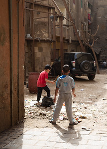 Kids playing in an alley in the Old Jewish Quarter of Cairo. Beyond them is the brick wall we hit when trying to find a Jewish landmark.