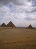 The pyramids on the Giza Plateau with the city of Cairo looming in the background.
