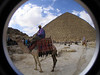 Egyptian camel riders in front of The Great Pyramid of Khufu.