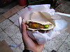 Egyptian street food, a felafel sandwhich: balls of mashed broad beans & spices, fried & placed in pita bread with veggies. Yum!