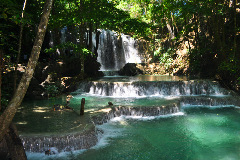 The beautiful light azure waterfall pools of Moyo Island, just over an hour boat excursion away from Sambawa Island in Indonesia. A hot pick for travel.