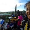 Nicole's motorcycle breaks down in Kibale, Uganda, while riding solo, and the whole village comes out to help. A beautiful Muslim family takes her in for the night.