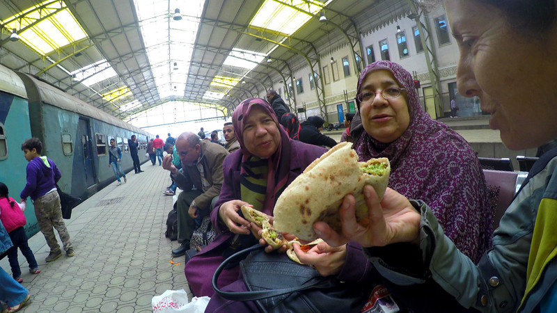 Nicole eats the best falafel of her life after making fast friends at the Cairo train station. The offering of cultural food, the common language of love.