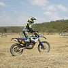 Riding Husaberg 390s next to zebra with safari motorcycle adventure company Dusty Helmets on Soysambu Conservancy in Kenya.