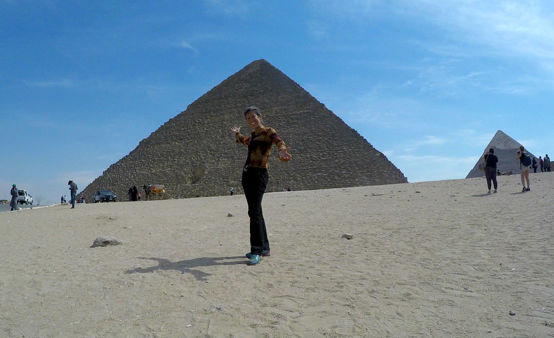 Feeling the powerful Great Pyramid in Giza, Egypt.