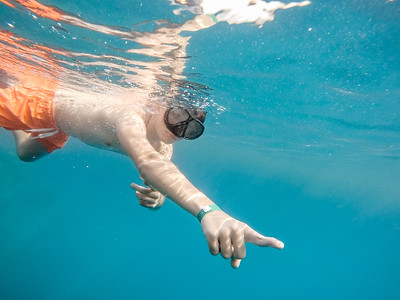 Young boy Snorkel swim in coral reef