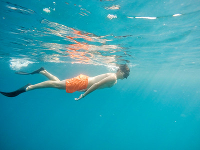 Young boy Snorkel swim in red sea