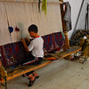 Local  children learn to weave beautiful carpets