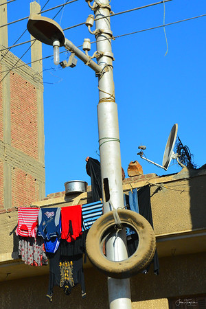 Hanging the laundry.  Cairo - the view from the bus.