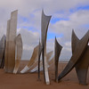 Les Braves Omaha Beach Memorial.<br /> <br /> Les Braves consists of three elements:<br />    The wings of Hope<br />    Rise, Freedom!<br />    The Wings of Fraternity