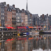 The Old Dock of Honfleur surrounded by picturesque narrow houses