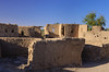 Ruins of a former residential area in the desert oasis village of Bawiti, Egypt.