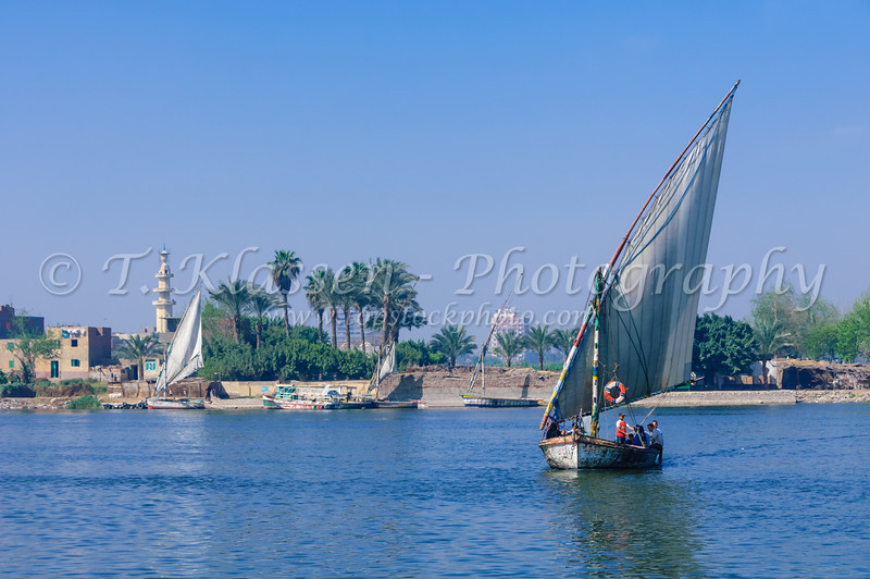 Felucca sailboat crossing the Nile River to Gold Island, Cairo, Egypt.