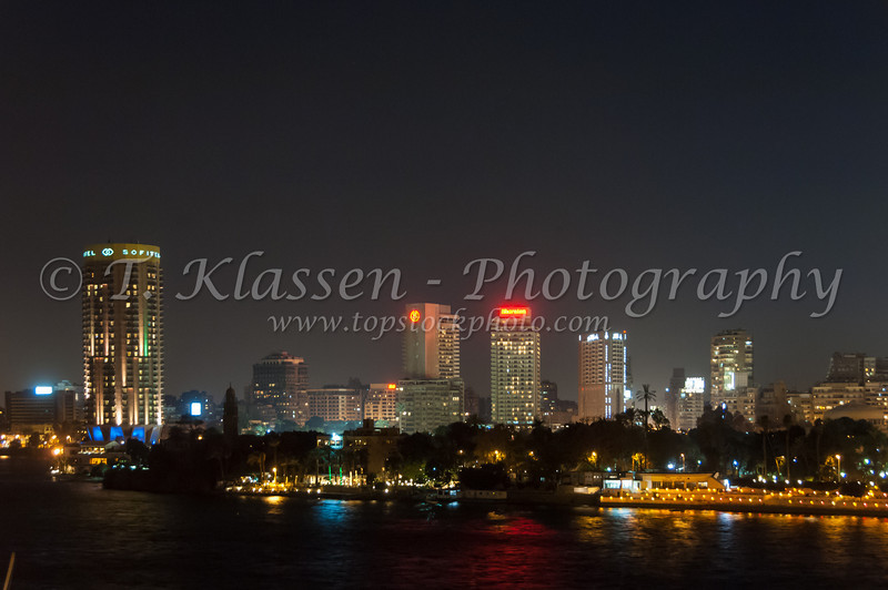 The city of Cairo and the Nile River at night, Egypt.