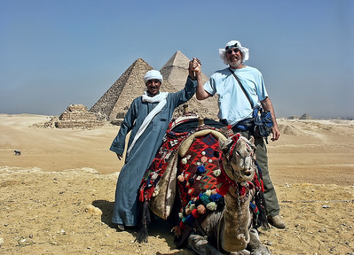 A camel with rider and new friend at the Great Pyramid