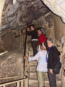 The women climb stairs inside the Great Pyramid