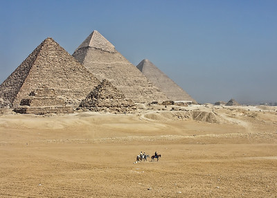 Riding horses under the Giza Pyramids