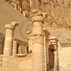 The inner sanctuary of the early new kingdom mortuary temple of Queen Hatshepsut at Thebes in Egypt in very fine sandstone, with mountains behind