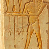 Woman bearing vases and the symbols of life in The early new kingdom mortuary temple of Queen Hatshepsut at Thebes in Egypt